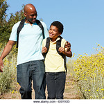 UN14.21 / to replace the photo of the African-American father and son walking and talking / Choice 13 of 13