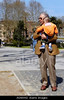 Fig 4.25 / Italian grandfather pushing a stroller or interacting with grandchild<br /> <br /> Choice 3 of 10<br /> <br /> AG4AW2 Grandfather holding up his grandson in the park Rome Italy. Image shot 2006. Exact date unknown.