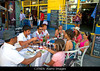 Fig 3.10 / Photo of four or more friends having coffee or eating at an outdoor cafe in Spain or in any Spanish-speaking country. The friends are not tourists.<br /> <br /> Choice 8 of 12<br /> <br /> C3TAEN People dine at an outdoor cafe in the La Boca barrio of Buenos Aires, Argentina.