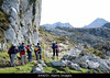 CO10 <br /> <br /> Choice 4 of 12<br /> <br /> A4425Y Hikers set off on a trek route RUTA VEGA DE ARIO REFUGIO in the PICOS DE EUROPA mountain range in northern Spain