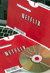 P19.1 / Choice 9 of 9  A Netflix Inc. DVD and envelopes are arranged for a photograph in New York, U.S., on Thursday, Sept. 15, 2011. Netflix Inc., the mail-order and online film-rental serv ...
