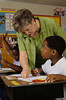 TA7.14 / New photo requested / what are some good teaching strategies for guiding children's long-term memory / teacher with students<br /> <br /> Choice 9 of 14<br /> <br /> North Carolina, USA --- Teacher Assisting Student During Exam --- Image by © Will & Deni McIntyre/CORBIS