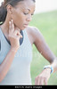 m106 TA4.13 / Choice 5 of 9 / B8JYCN Woman monitoring heart rate