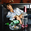 Additional TA13.9 <br /> <br /> Choice 11 of 12<br /> <br /> Portrait of a young man passed out on the couch --- Image by © Ocean/Corbis