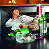 Additional TA13.9 <br /> <br /> Choice 10 of 12<br /> <br /> Man passed out on couch --- Image by © Ocean/Corbis