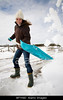 TA5.4 / Woman shoveling snow<br /> <br /> Choice 7 of 11<br /> <br /> BFYX8D Woman clearing snow