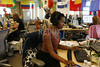 P14.1 / Facebook<br /> Choice 9 of 9<br /> <br /> Employees at work at the Facebook headquarters. Some areas of the office have flags from foreign countries to highlight multi-lingual Facebook employees that handle issues with members in non English-speaking countries.