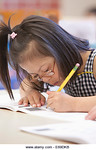 Un16.16 / New photo requested of child with down syndrome in classroom setting, choice 10 of 13